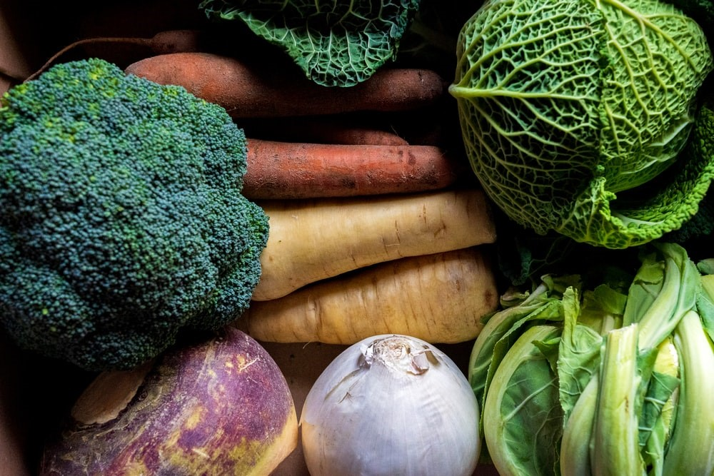 green and brown vegetables on brown wooden table